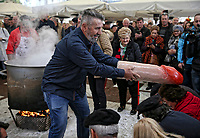 Pictured: A pan with touches a giant penis shaped object on the heads of women in Tirnavos, central Greece. 19 February 2018<br /> Re: Bourani (or Burani) the infamous annual carnival which dates to 1898 which takes place on the day of (Clean Monday), the first days of Lent in Tirnavos, central Greece, in which men hold phallus shaped objects as scepters in their hands.