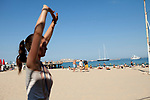 Maude practising Kalaripayattu, Plage des Catalans, Marseille, 16.06.2011 . || Kalaripayattu is a traditional Indian martial art and Maude practises here on the beach every morning.