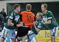 Handball 2. Bundesliga Herren - SC DHfK gegen HC Erlangen am 05.11.2013 in Leipzig (Sachsen). <br /> IM BILD: Rico Göde / Goede (DHfK), Ulrich Streitenberger (DHfK) und Pavel Prokopec (DHfK) nehmen Christoph Nienhaus in die Mangel <br /> Foto: Christian Nitsche