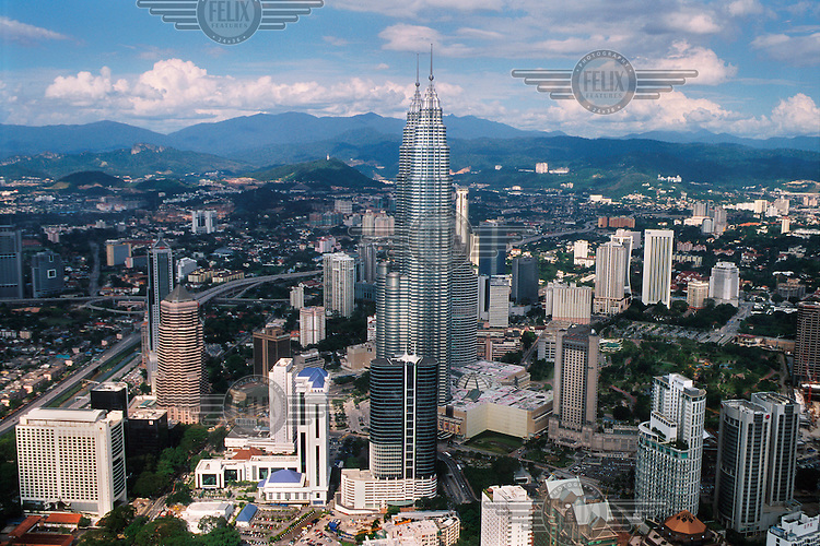 View of the city, including the Petronas Towers, which at 451.9 metres were once the tallest buildings in the world.