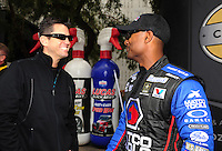 Feb. 12, 2012; Pomona, CA, USA; NHRA top fuel dragster driver Antron Brown (right) talks with Larry Dixon during the Winternationals at Auto Club Raceway at Pomona. Mandatory Credit: Mark J. Rebilas-