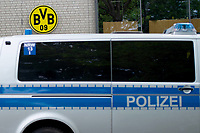 16th May 2020, Signal Iduna Park, Dortmund, Germany; Bundesliga football, Borussia Dortmund versus FC Schalke;  Outdoor shot before the first matchday of the Ghost Games because of the coronavirus. In the picture police car in front of a logo, emblem of Borussia Dortmund Dortmund