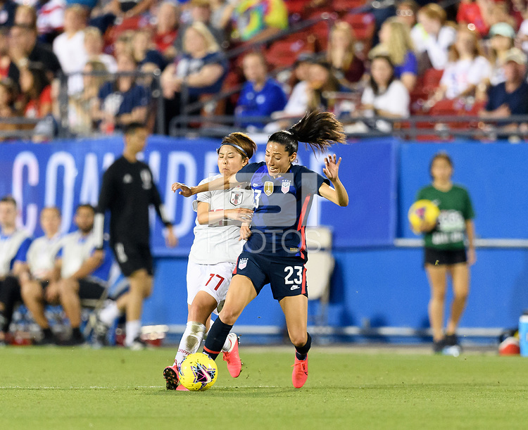 FRISCO, TX - MARCH 11: Christen Press #23 of the United States and Narumi Miura #17 of Japan battle for the ball in the first half during a game between Japan and USWNT at Toyota Stadium on March 11, 2020 in Frisco, Texas.