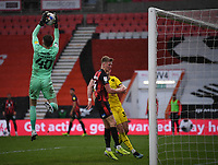 13th March 2021; Vitality Stadium, Bournemouth, Dorset, England; English Football League Championship Football, Bournemouth Athletic versus Barnsley; Bradley Collins of Barnsley catches the shot under pressure from Sam Surridge of Bournemouth