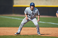 Zack Miller (46) of the Catawba Indians takes his lead off of first base during game two of a double-header against the Queens Royals at Tuckaseegee Dream Fields on March 26, 2021 in Kannapolis, North Carolina. (Brian Westerholt/Four Seam Images)