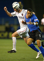 8 May 2004:  MetroStars Eddie Gaven battles for the ball in the air with Earthquakes Ramiro Corrales at Spartan Stadium in San Jose, California.   Earthquakes and MetroStars are tied at 5-5..Mandatory Credit: Michael Pimentel/ISI