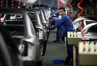 Workers at the Geely automobile factory work on the assembly line at the company's site in Ningbo, China. Geely's profit rose 88 percent in 2006 as it sold more mid-range cars.