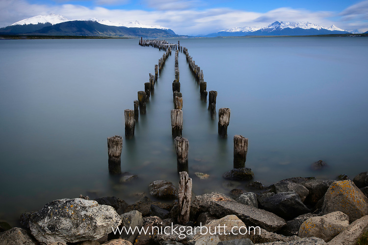 Old jetty and Golfo Almirante Montt near Puerto Natales, southern Patagonia, Chile. Extremely long exposure (Big Stopper) to blur water movement.