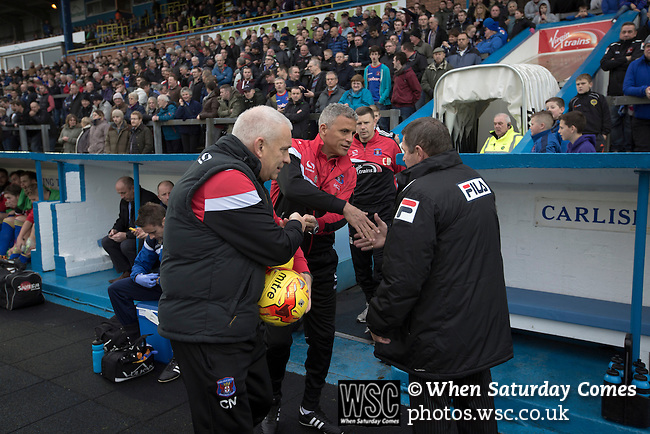 Carlisle United 1 Accrington Stanley 0, 15/11/2014. Brunton Park, League Two. Home team manager Keith Curle (centre) shaking hands prior to kick-off at the English League Two match between Carlisle United and visitors Accrington Stanley at Brunton Park. The match was won by the home team by one goal to nil, the winner scored by Derek Asamoah in the 21st minute. The match was watched by 4,069 spectators. Photo by Colin McPherson.