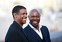 """Actor Denzel Washington (L) and director Antoine Fuqua attend a pohotocall to promote their film """"The Equalizer"""" during the 62nd San Sebastian Film Festival on September 19, 2014, Basque country. (Ander Gillenea / Bostok Photo)"""
