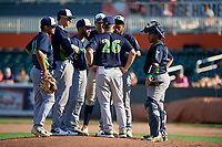 Vermont Lake Monsters Aaron Nieckula (26) talks with pitcher Leudeny Pineda (16) before making a pitching change during a NY-Penn League game against the Aberdeen IronBirds on August 18, 2019 at Leidos Field at Ripken Stadium in Aberdeen, Maryland.  Vermont defeated Aberdeen 6-5.  Others shown (L-R) Jordan Diaz (12), Logan Davidson (3), Yerdel Vargas (2), Dustin Harris (21), catcher Jorge Gordon (9).  (Mike Janes/Four Seam Images)