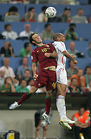 French forward (12) Thierry Henry goes up for a header against Portuguese defender (16) Ricardo Carvalho.  France defeated Portugal, 1-0, in their FIFA World Cup semifinal match at FIFA World Cup Stadium in Munich, Germany, July 5, 2006.