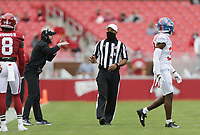 An official gestures, Saturday, October 17, 2020 during the second quarter of a football game at Donald W. Reynolds Razorback Stadium in Fayetteville. Check out nwaonline.com/201018Daily/ for today's photo gallery. <br /> (NWA Democrat-Gazette/Charlie Kaijo)