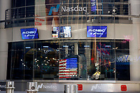 NEW YORK, NEW YORK - MARCH 10: View of Nasdaq window at Times Square on March 10, 2021, in New York. The Nasdaq Composite continued falling more than half a percent during the day also the move away from Apple Inc, Amazon.com Inc , Facebook Inc, Tesla Inc and Microsoft Corp, falling during the day, helped small-cap stocks rise more than double the gains of the S&P 500. (Photo by John Smith/VIEWpress)