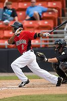 James Andres #1 of the Hickory Crawdads follows through on his swing versus the West Virginia Power at L.P. Frans Stadium June 21, 2009 in Hickory, North Carolina. (Photo by Brian Westerholt / Four Seam Images)