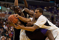 Washington's Quincy Pondexter (left) and California's Omondi Amoke (right) battle for the ball. The Washington Huskies defeated the California Golden Bears 79-75 during the championship game of the Pacific Life Pac-10 Conference Tournament at Staples Center in Los Angeles, California on March 13th, 2010.