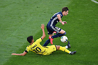 15th March 2020, Wellington, New Zealand;  Phoenix's Ulises Davila Plascencia slide  tackles Victory's James Donachie during the A-League - Wellington Phoenix versus Melbourne Victory football match at Sky Stadium in Wellington on Sunday the 15th March 2020.