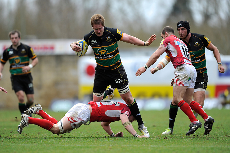 GJ van Velze of Northampton Saints evades Michael Hills  of London Welsh during the Aviva Premiership match between London Welsh and Northampton Saints at the Kassam Stadium on Sunday 14th April 2013 (Photo by Rob Munro)