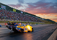 Jul 19, 2019; Morrison, CO, USA; The sun sets as NHRA funny car driver Ron Capps races during qualifying for the Mile High Nationals at Bandimere Speedway. Mandatory Credit: Mark J. Rebilas-USA TODAY Sports