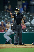 home plate umpire Jake Bruner makes a strike call during the Carolina League game between the Winston-Salem Dash and the Myrtle Beach Pelicans at TicketReturn.com Field on May 16, 2019 in Myrtle Beach, South Carolina. The Dash defeated the Pelicans 6-0. (Brian Westerholt/Four Seam Images)
