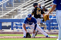 Toronto Blue Jays first baseman Rowdy Tellez (44) stretches for a throw as Hunter Owen (94) runs through the bag during a Major League Spring Training game against the Pittsburgh Pirates on March 1, 2021 at TD Ballpark in Dunedin, Florida.  (Mike Janes/Four Seam Images)