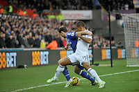 SWANSEA, WALES - JANUARY 17:   of  during the Barclays Premier League match between Swansea City and Chelsea at Liberty Stadium on January 17, 2015 in Swansea, Wales.<br /> <br /> Swansea's Wayne Routledge losing out to Gary Cahill