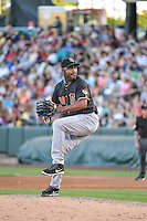 Jose Veras (38) of the Fresno Grizzlies delivers a pitch to the plate against the Salt Lake Bees in Pacific Coast League action at Smith's Ballpark on June 13, 2015 in Salt Lake City, Utah.  (Stephen Smith/Four Seam Images)