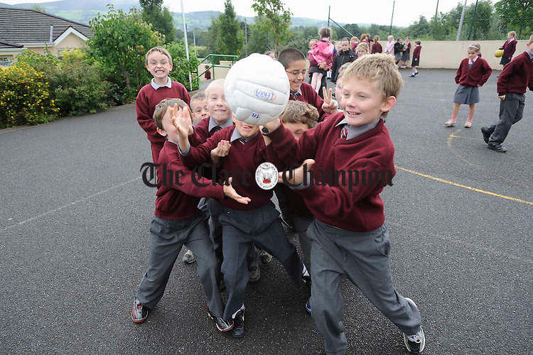 The lads get going on a game of ball at Ogonelloe NS. Photograph by John Kelly.