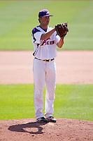 Sam Johns (19) of the Evansville Purple Aces stands on the mound during a game against the Indiana State Sycamores in the 2012 Missouri Valley Conference Championship Tournament at Hammons Field on May 23, 2012 in Springfield, Missouri. (David Welker/Four Seam Images).