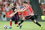 Athletic de Bilbao's Aymeric Laporte (r) and FC Barcelona's Leo Messi during La Liga match. August 28,2016. (ALTERPHOTOS/Acero)