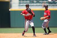 Indianapolis Indians shortstop Pedro Florimon (17) makes a throw to first base against the Charlotte Knights at BB&T BallPark on June 21, 2015 in Charlotte, North Carolina.  The Knights defeated the Indians 13-1.  (Brian Westerholt/Four Seam Images)