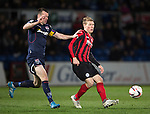 Ross County v St Johnstone....07.04.15   SPFL<br /> David Wotherspoon fends off Paul Quinn<br /> Picture by Graeme Hart.<br /> Copyright Perthshire Picture Agency<br /> Tel: 01738 623350  Mobile: 07990 594431