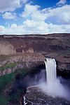A sunny, partly cloudy day looking over Palouse Falls near Washtucna, Washington state.