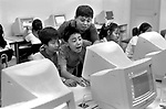 """The Peoples Republic of China. Shanghai. 2000.   Young Pioneers at an after-school club school enjoying a computer class. Known as """" Childrens Palaces"""" there are thirteen of these arts and recreation centres in Shanghai.  Each year some 250,000 children under 16 attend classes in dance, music, crafts, calligraphy - and computers."""