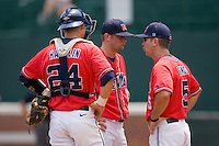 Ole Miss Rebels head coach Mike Bianco #5 has a chat with his pitcher David Goforth #7 and catcher Miles Hamblin #24 at the Charlottesville Regional of the 2010 College World Series at Davenport Field on June 6, 2010, in Charlottesville, Virginia.  The Red Storm defeated the Rebels 20-16.  Photo by Brian Westerholt / Four Seam Images