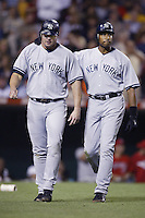 Jason Giambi and teammate Bernie Williams of the New York Yankees during a 2002 MLB season game against the Los Angeles Angels at Angel Stadium, in Anaheim, California. (Larry Goren/Four Seam Images)