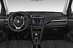 Stock photo of straight dashboard view of2013 Suzuki SWIFT Grand Luxe @ttraction 5 Door Hatchback 2WD Dashboard