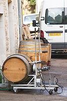 Oak barrel aging and fermentation cellar. Cleaning old barrels. The village. Pommard, Cote de Beaune, d'Or, Burgundy, France