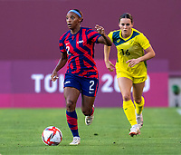 KASHIMA, JAPAN - AUGUST 5: Crystal Dunn #2 of the USWNT dribbles during a game between Australia and USWNT at Kashima Soccer Stadium on August 5, 2021 in Kashima, Japan.