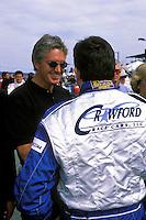 Eddie Cheever, Jr. (Sunglasses) talks with Tony Stewart. #2 Crawford...2002 Rolex 24 at Daytona, Daytona International Speedway, Daytona Beach, Florida USA Feb. 2002.(Sports Car Racing)