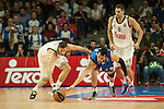 Real Madrid´s Rudy Fernandez and Anadolu Efes´s Dario Saric during 2014-15 Euroleague Basketball match between Real Madrid and Anadolu Efes at Palacio de los Deportes stadium in Madrid, Spain. December 18, 2014. (ALTERPHOTOS/Luis Fernandez)