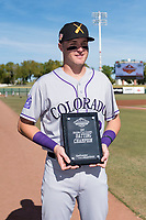 Salt River Rafters first baseman Tyler Nevin (2), of the Colorado Rockies organization, poses with the 2018 Arizona Fall League Champion Award before the Arizona Fall League Championship Game against the Peoria Javelinas at Scottsdale Stadium on November 17, 2018 in Scottsdale, Arizona. (Zachary Lucy/Four Seam Images)