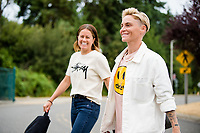 TACOMA, WA - JULY 31: Jessica Fishlock #10 and Lauren Barnes #3 of the OL Reign arrive at the stadium before a game between Racing Louisville FC and OL Reign at Cheney Stadium on July 31, 2021 in Tacoma, Washington.