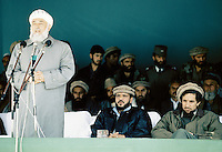 President Borhan'udin Rabani with  General Abdul Quassim Fahim and Warlord Ahmad Shah Massoud at a Mudjahedin parade, celebrating the liberation of Charikar from the communist army.