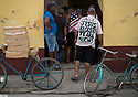 27/07/18<br /> <br /> A man with religious sign on his back translates to 'Jesus loves you very much' queues for his daily bread outside bakery. Trinidad, Cuba.<br /> <br /> All Rights Reserved, F Stop Press Ltd. (0)1335 344240 +44 (0)7765 242650  www.fstoppress.com rod@fstoppress.com