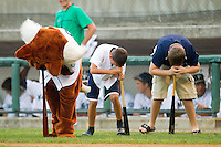 The Pulaski Mariners mascot participates in the dizzy bat race with two fans at Calfee Park August 29, 2010, in Pulaski, Virginia.  Photo by Brian Westerholt / Four Seam Images