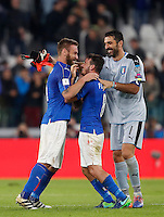 From left, Italy's Daniele De Rossi, Alessandro Florenzi and Gianluigi Buffon celebrate at the end of the Fifa World Cup 2018 qualification soccer match between Italy and Spain at Turin's Juventus Stadium, October 6, 2016. The game ended 1-1.<br /> UPDATE IMAGES PRESS/Isabella Bonotto
