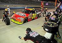 Feb 22, 2009; Fontana, CA, USA; NASCAR Sprint Cup Series driver Jeff Gordon pits during the Auto Club 500 at Auto Club Speedway. Mandatory Credit: Mark J. Rebilas-