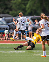 In a National Women's Soccer League Elite (NWSL) match, Portland Thorns FC defeated the Boston Breakers, 2-1, at Dilboy Stadium on July 21, 2013.  Boston Breakers goalkeeper Ashley Phillips (24) slides to kick  the ball away as Portland Thorns FC forward Christine Sinclair (12) leaps to intercept it.