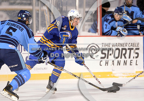 Buffalo Junior Sabres forward Ryan Kuhn (16) controls the puck during a game against the St. Michaels Buzzers at the Frozen Frontier outdoor game at Frontier Field on December 15, 2013 in Rochester, New York.  St. Michael's defeated Buffalo 5-4.  (Copyright Mike Janes Photography)